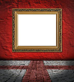 Golden frame on red plaster background Royalty Free Stock Photography