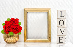 Golden frame red roses. Mock up space for picture Stock Photos