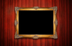 Golden frame on red wall Stock Photos
