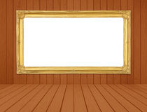 Golden frame in room with white wood wall and wood floor backgro Stock Images