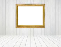 Golden frame in room with white wood wall and wood floor backgro Royalty Free Stock Photography