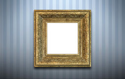 Golden frame on the wall. Golden frame for a picture on the wall with striped wallpaper in the room Stock Photography