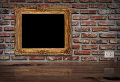 Golden frame on the wall. Royalty Free Stock Photo