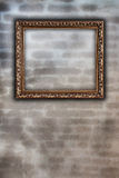Golden frame on wall Royalty Free Stock Photos