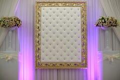 Golden frame on white wall Stock Image
