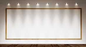 Golden frame on white wall Royalty Free Stock Image