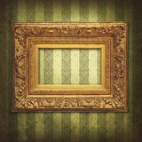 Golden frame on a wintage wallpaper. Vintage texture with grunge effects and golden frame royalty free stock photos