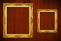Golden frame on wood Royalty Free Stock Image