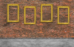 Golden frames on brick wall Royalty Free Stock Image