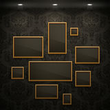 Golden frames on the wall. Vintage background Royalty Free Stock Photos