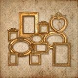 Golden framework over vintage pattern wallpaper Stock Image