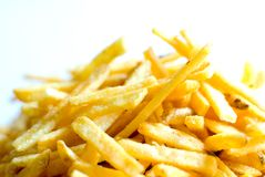 Golden French fries. A close-up image of golden French fries stock image