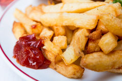Golden French fries Stock Photography