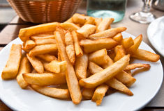 Golden French fries potatoes Royalty Free Stock Photo