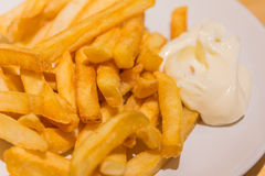 Golden French fries potatoes ready to be eaten Stock Photos