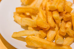 Golden French fries potatoes ready to be eaten Royalty Free Stock Photography
