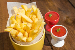 Golden French fries potatoes Royalty Free Stock Photos