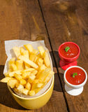 Golden French fries potatoes Stock Photos