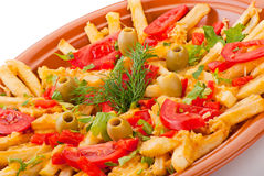 Golden French fries potatoes with tomato and olive Stock Photography