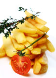 Golden french fries served with tomato Stock Photos