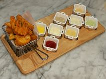 Golden French fries serving in the basket with 8 dipping sauces, ketchup and mayo, stylist food, fusion food. Top view stock photos