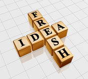 Golden fresh idea like crossword. 3d golden boxes with black letters with text - fresh idea, crossword Royalty Free Stock Image