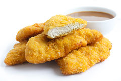 Golden fried chicken strips on white. Stock Image