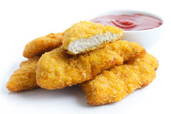 Golden fried chicken strips on white. Stock Photos