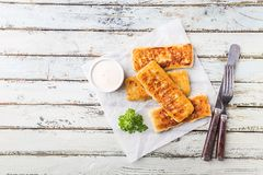 Golden fried fish fingers stock photo