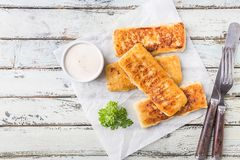 Golden fried fish fingers royalty free stock images