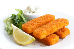 Golden fried fish fingers with lemon and tartar sauce Stock Images