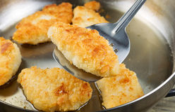 Golden Fried Fish in Pan Stock Photos