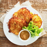 Golden fried potato fritters with mustard Stock Photography