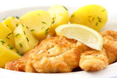 Golden fried schnitzel with boiled potatoes Royalty Free Stock Photo