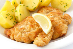 Golden fried schnitzel with boiled potatoes Stock Photos