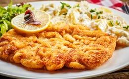 Golden fried schnitzel royalty free stock photos