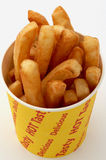 Golden fries in a chip bucket Royalty Free Stock Photo