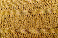 The golden fringe. Golden twisted fringe wrapped in several layers stock photos