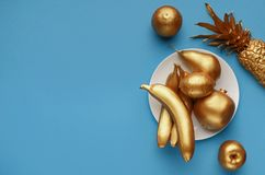 Golden fruits on plate royalty free stock photo