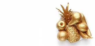 Golden fruits on plate stock image