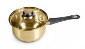 Golden frying pan Stock Image