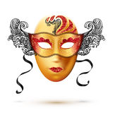 Golden full face carnival mask with ornate lacy black sides Royalty Free Stock Photos