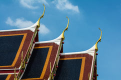 Golden gable apex on the roof of  Thai temple, Bangkok. Stock Photo