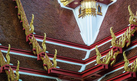 Golden gable apex on the roof of  Thai temple, Bangkok. Stock Photos