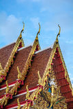 Golden gable apex on the roof of  Thai temple, Bangkok. Royalty Free Stock Photography