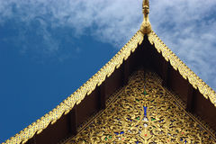 Golden gable apex and striped thailand on chapel Royalty Free Stock Image
