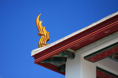Golden gable apex. On top of Thailand Temple Stock Photo