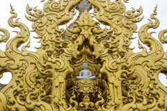 Golden gable apex in Wat Rong Khun Stock Image