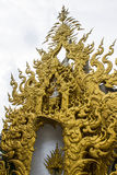 Golden gable apex in Wat Rong Khun Royalty Free Stock Photos