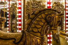 Antic retro carousel with golden horses mirrors and lamps stock images